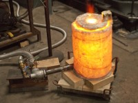 The crucible was brought to a very high temperature in a simple refractory-blanket furnace fired with natural gas.