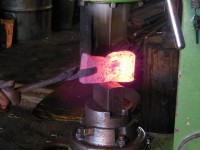 Shaping the axe during the welding process.