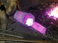Borax flux is applied to get a complete weld on the edge of the socket.