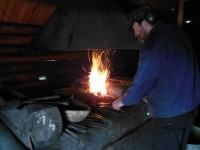 Mattias uses a mix of coal and charcoal to heat treat his tools.  The darkness inside the old smithy is good for judging the temperature of the work.  The only sounds inside the smithy right now come from the fire and from the old bellows.