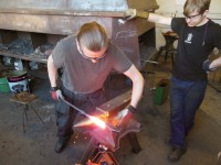 Forge welding a high carbon steel face to a mild steel body - the first step of making a forge welded hammer.