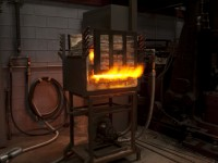The charge is fired in the furnace for a period of about 4.5 hours at a temperature of about 2000 degrees Fahrenheit.  Higher temperatures and longer times both lead to greater carbon uptake in the charge.  It is easily possible to over-carburize the metal - even to the point of creating cast iron.